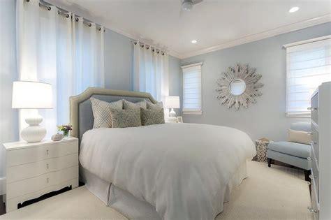 white  blue bedroom  silver sunburst mirror