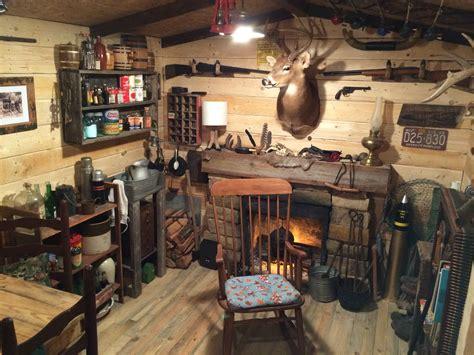 man turns unused basement room   log cabin replica