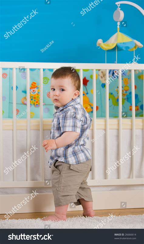 Crib 1 Year by Sweet Baby Boy 1 Year Standing At Children S Room