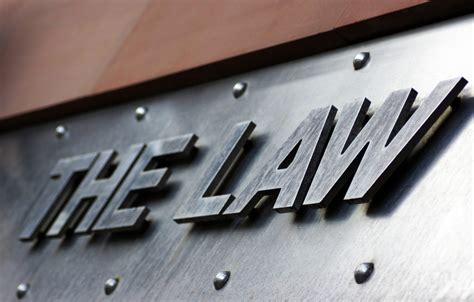sections of the law the law a section on of the sign above the entrance into