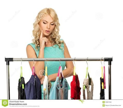 whats clothes are in for a woman in her 50s woman choosing clothes stock photo image 39967502