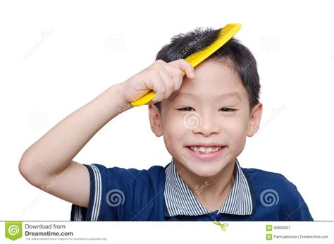 how to comb a boys hair boy combs his hair by yellow comb stock image image