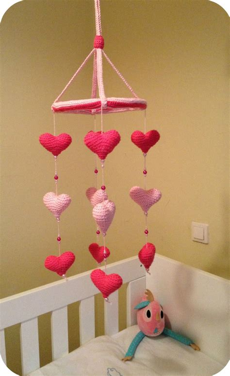 baby crib mobile with pink and fuchsia crocheted by
