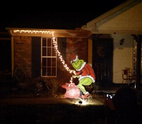 grinch pulling down lights grinch encompassingchaos