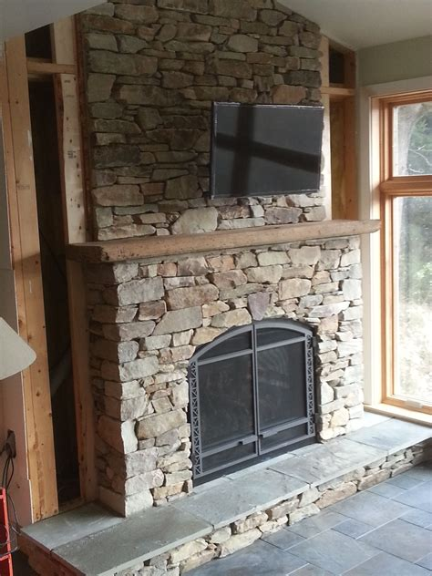 fireplace surround using natural veneer stone with a cut