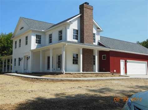 Farmhouse With Attached Garage by Hostetler Builders