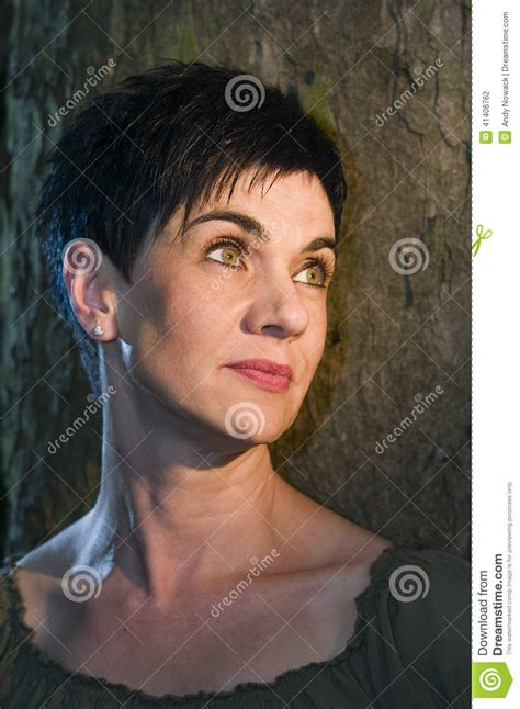 dark hair on middle aged women beauty by the tree stock photo image 41406762