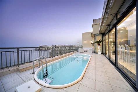 Pool Area by Superb Luxury Penthouse In Portomaso Malta