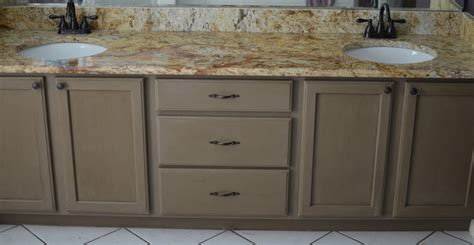 chalk painting bathroom cabinets the thrifty spender bathroom cabinet make over with chalk