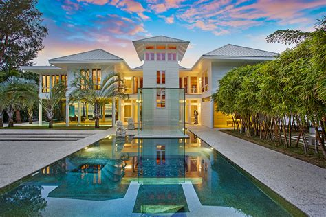 mansion global explore a glass walled mansion set between a beach and a