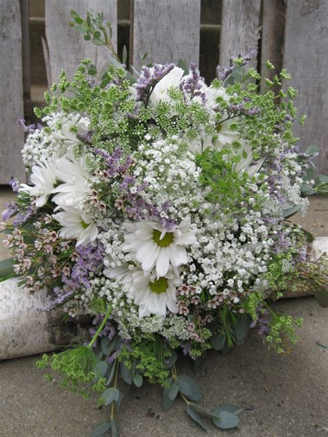 hand tied bouquet created  white daisies white wax