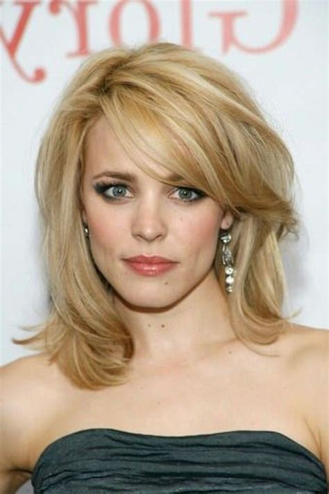 ladies hair styles with swept over fringe medium length haircuts with short side swept bangs