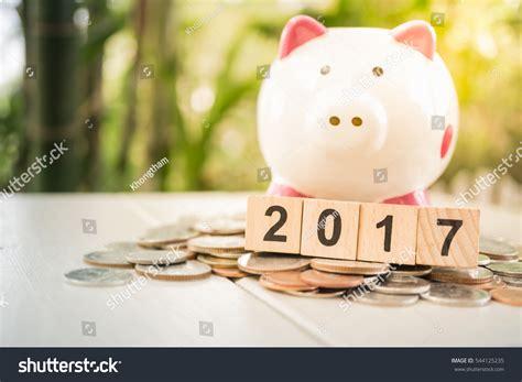 new year bank in money 2017 new year wooden blocks piggy stock photo 544125235