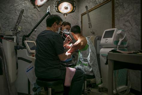 tattoo removal korea south korean plastic surgeons help northern defectors