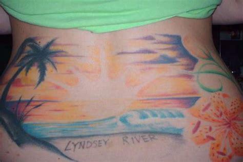 tattoo girl beach beach tattoo on girl lowerback