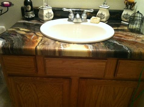 Epoxy Paint For Laminate Countertops by Formica Countertop Covered In A Decorative Epoxy Color Combination Before After