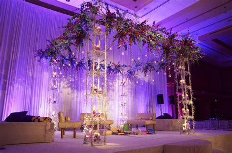 Large grand Mandap design with hanging orchids and light