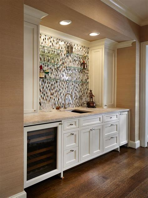 bar cabinet with built in wine cooler this neutral traditional kitchen bar features a stainless