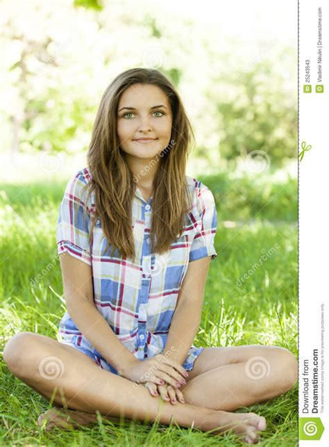 beautiful teen beautiful teen girl in the park at green grass stock