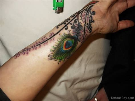 tattoo feather on arm arm tattoos tattoo designs tattoo pictures page 30