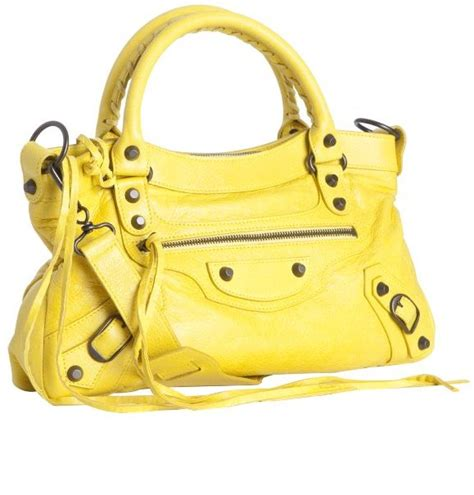 Charlize Theron With And Balenciaga Purses by Charlize Theron Carrying A Yellow Balenciaga Bag
