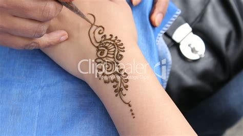 getting a tattoo on wrist getting a henna on wrist royalty free