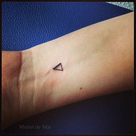 small triangle inked