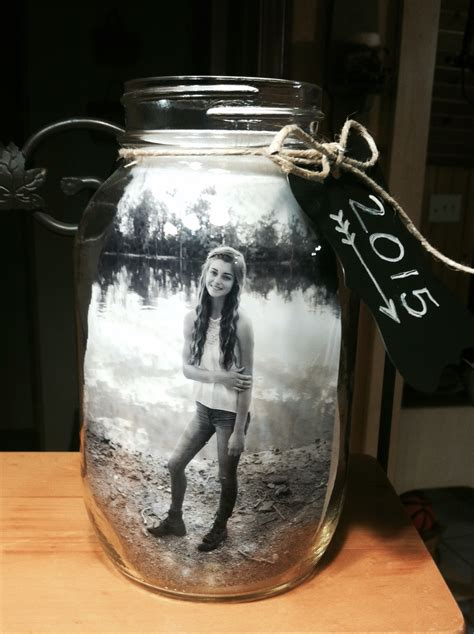 jar centerpieces jar centerpiece for graduation i put 2 pictures in