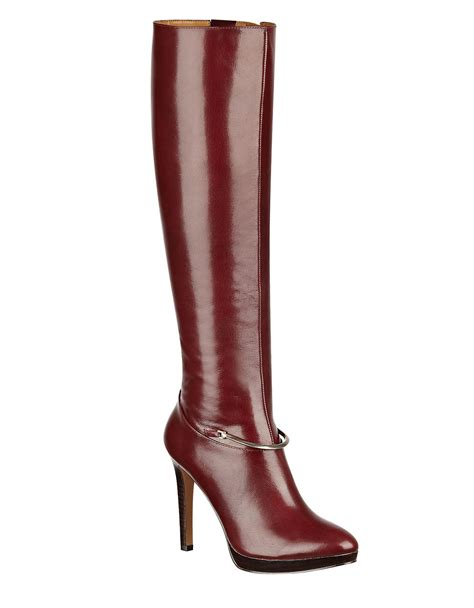 nine west pearson knee high platform leather boots in