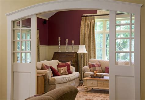 arch living room houzz pocket doors traditional family room other metro