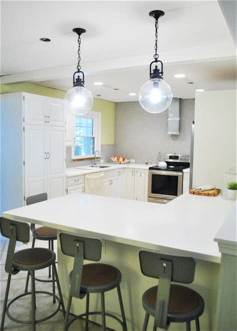Hanging Two Oversized Glass Kitchen Pendants Young House Pendant Lights Peninsula