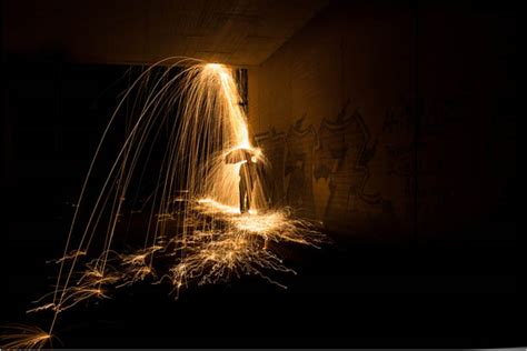 a creative light painting photograph that makes sparks