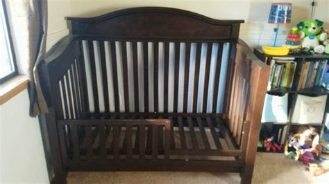 crib that turns into full size bed find more price reduced espresso baby crib toddler bed