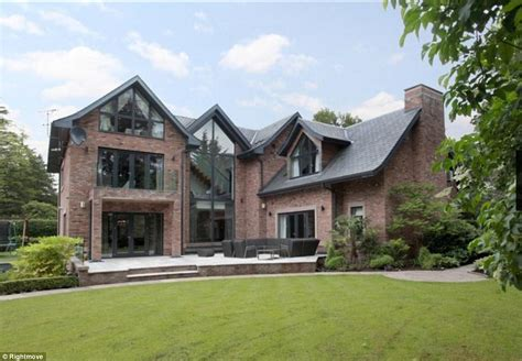 2 bedroom houses for sale in manchester phil neville puts cheshire mansion up for sale after