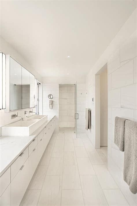 modern  white bathroom  long double vanity hgtv