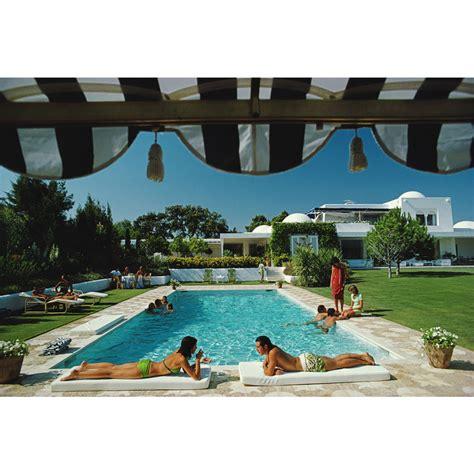 poolside with slim aarons 0810994070 slim aarons poolside in sotogrande photograph modern art jonathan adler