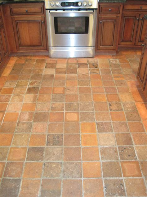 Kitchen Tile Flooring Ideas Square Brown Tile Kitchen Floor Combined With Brown Wooden Cabinet With Silver Stove Oven