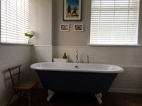 wooden blinds bathroom how to dress your bathroom windows with wooden blinds