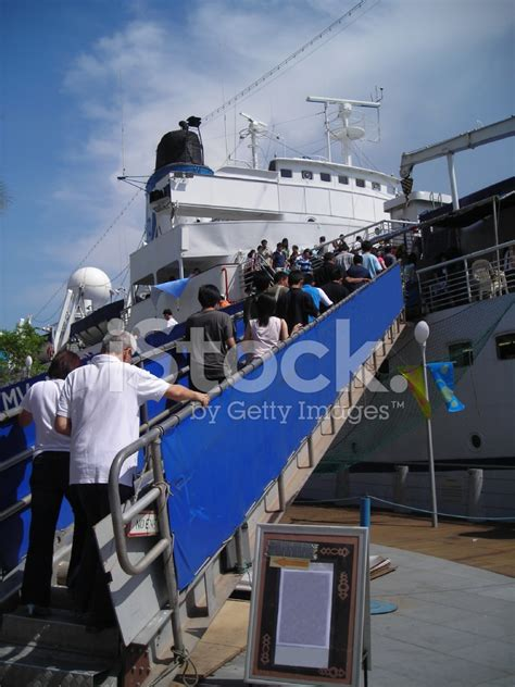 Ship Boarding Passengers Boarding Ship To Go On A Journey Stock Photos