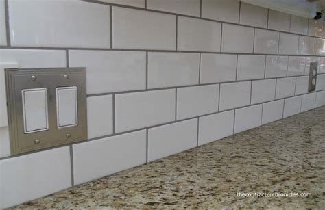 subway tiles backsplash brown kitchen cabinets with white subway tile quicua com