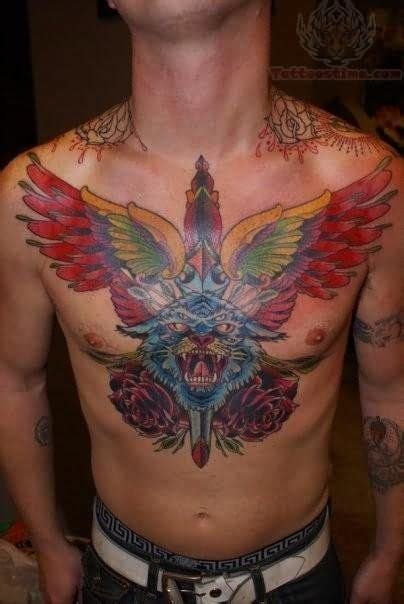 chest tattoo knife winged dagger and leopard tattoo on chest tattoos