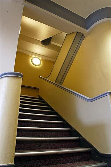 grey yellow walls stairs with yellow walls gray trim interior