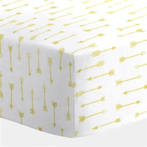 white and gold arrows crib sheet carousel designs