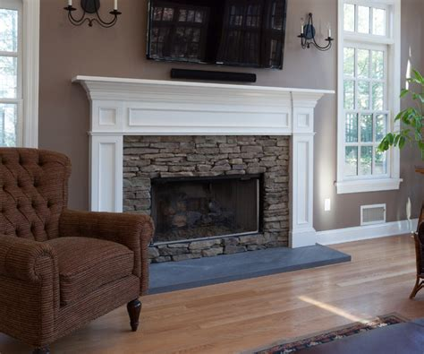new fireplace design with white mantel and cream wall fireplace mantle in white with stacked stone surround set