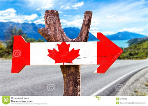 wooden canada canada wooden sign with a road background stock photo