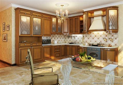 cocinas clasicas de madera #1: kitchen-cabinets-traditional-medium-wood-golden-brown-089-s38818531x2-wood-hood-light-glass.jpg