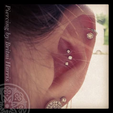 black hole body piercing and tattoo conch piercing done with neometal pushpins with