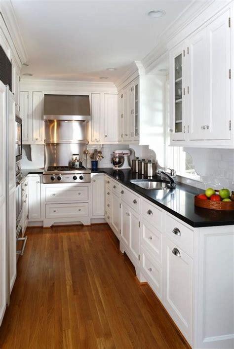 kitchens ideas with white cabinets best 25 black granite countertops ideas on black granite kitchen black granite