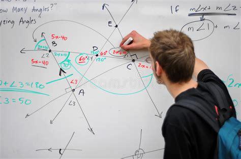 whiteboard math stock photos whiteboard student writing math on whiteboard stock photo image 14322464