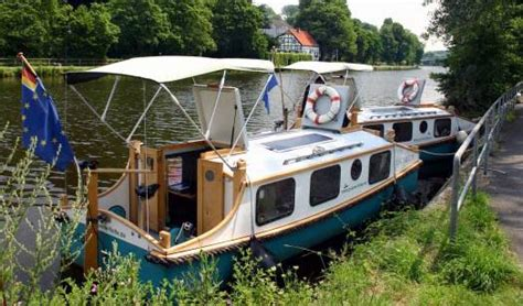 pedal powered canal boat pedaling afloat with phil thiel s tiny houseboats